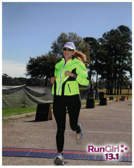 "Alexis' finish at her first ever half marathon - Run Girl HM Dec. 2010. ""I was crying my eyes out by the time I crossed the finish line.  I was in the middle of a very sad divorce, and running probably saved my life. The sense of accomplishment and empowerment was unbelievable."""